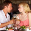 Couple Enjoying Meal In Restaurant — Стоковое фото
