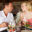 Stock Photo: Couple Enjoying Meal In Restaurant
