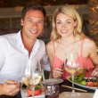 Couple Enjoying Meal In Restaurant — Foto de Stock