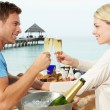 Stock Photo: Couple Enjoying Meal In Seafront Restaurant
