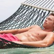 Stock Photo: Man Relaxing In Beach Hammock