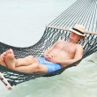 Stock Photo: Senior MRelaxing In Beach Hammock