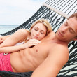 Stock Photo: Couple Relaxing In Beach Hammock