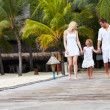 Family Walking On Wooden Jetty — Stock Photo #36837481