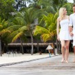 Couple Walking On Wooden Jetty — Stock Photo #36837493