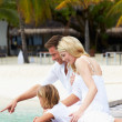 Stock Photo: Family Sitting On Wooden Jetty