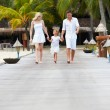 Stock Photo: Family Walking On Wooden Jetty