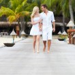 Couple Walking On Wooden Jetty — Stock Photo #36837577