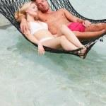 Couple Relaxing In Beach Hammock — Stock Photo
