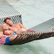 Family Relaxing In Beach Hammock — Stock Photo #36837655