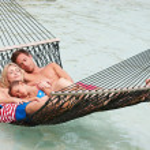 Family Relaxing In Beach Hammock — Stock Photo