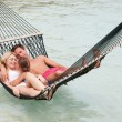 Family Relaxing In Beach Hammock — Stock Photo
