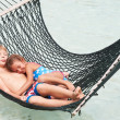 Brother And Sister Relaxing In Beach Hammock — Stock Photo #36837677
