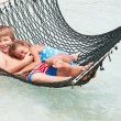 Brother And Sister Relaxing In Beach Hammock — Stock Photo