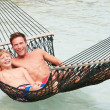 Father And Son Relaxing In Beach Hammock — Foto Stock