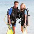 Couple With Scuba Diving Equipment Enjoying Beach Holiday — Stock Photo #36837751