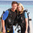 Couple With Scuba Diving Equipment Enjoying Beach Holiday — Stock Photo #36837753