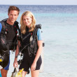 Stock Photo: Couple With Scuba Diving Equipment Enjoying Beach Holiday