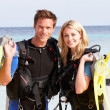 Stock Photo: Couple With ScubDiving Equipment Enjoying Beach Holiday