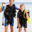 Father And Son With Scuba Diving Equipment On Beach Holiday — Stock Photo #36837789