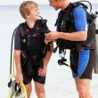 Father And Son With Scuba Diving Equipment On Beach Holiday — Stock Photo #36837805