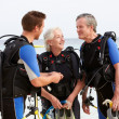 Stock Photo: Senior Couple Having ScubDiving Lesson With Instructor
