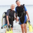 Senior Couple With Scuba Diving Equipment Enjoying Holiday — Stock Photo #36837861