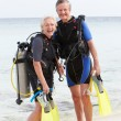 Senior Couple With Scuba Diving Equipment Enjoying Holiday — Stock Photo #36837865