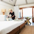 Stock Photo: Hotel Chambermaid Making Guest Bed