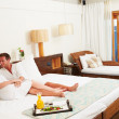 Couple Relaxing In Hotel Room Wearing Robes — Stock Photo