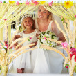 Bride And Bridesmaid Sitting Under Decorated Canopy — Photo