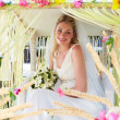Bride Sitting Under Decorated Canopy At Wedding — Foto de stock #36838117