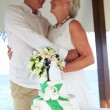Stock Photo: Senior Beach Wedding Ceremony With Cake In Foreground