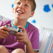 Boy Holding Controller Playing Video Game — Foto Stock #36838491