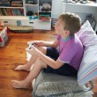 Boy Holding Controller Playing Video Game — Foto Stock #36838995