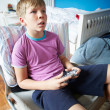 Boy Holding Controller Playing Video Game — Foto de Stock