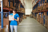 Female Worker In Distribution Warehouse — ストック写真