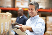 Worker Scanning Package In Warehouse — Foto Stock