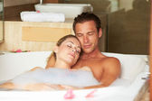 Couple Relaxing In Bubble Bath Together — 图库照片