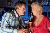 Senior Couple Enjoying Drink In Bar — Stock Photo