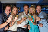 Group Of Friends In Bar — Stock Photo