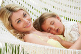 Mother And Daughter Relaxing In Beach Hammock — Foto de Stock