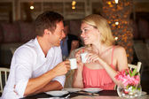 Couple Enjoying Cup Of Coffee In Restaurant — Stock Photo
