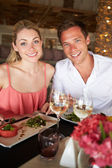 Couple Enjoying Meal In Restaurant — Stock Photo