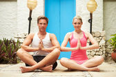 Couple Meditating Outdoors At Health Spa — Stock Photo