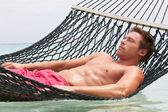 Man Relaxing In Beach Hammock — Stock Photo
