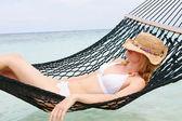 Woman Wearing Bikini And Sun Hat Relaxing In Beach Hammock — Stock Photo