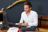 Hotel Receptionist Working At Computer — Stock Photo