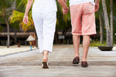 Detail Of Senior Couple Walking On Wooden Jetty — Stock Photo