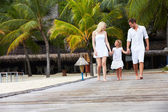 Family Walking On Wooden Jetty — 图库照片